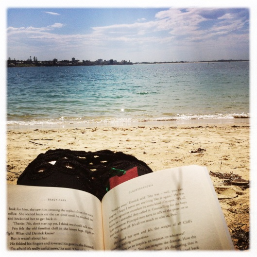 12 reading on the beach